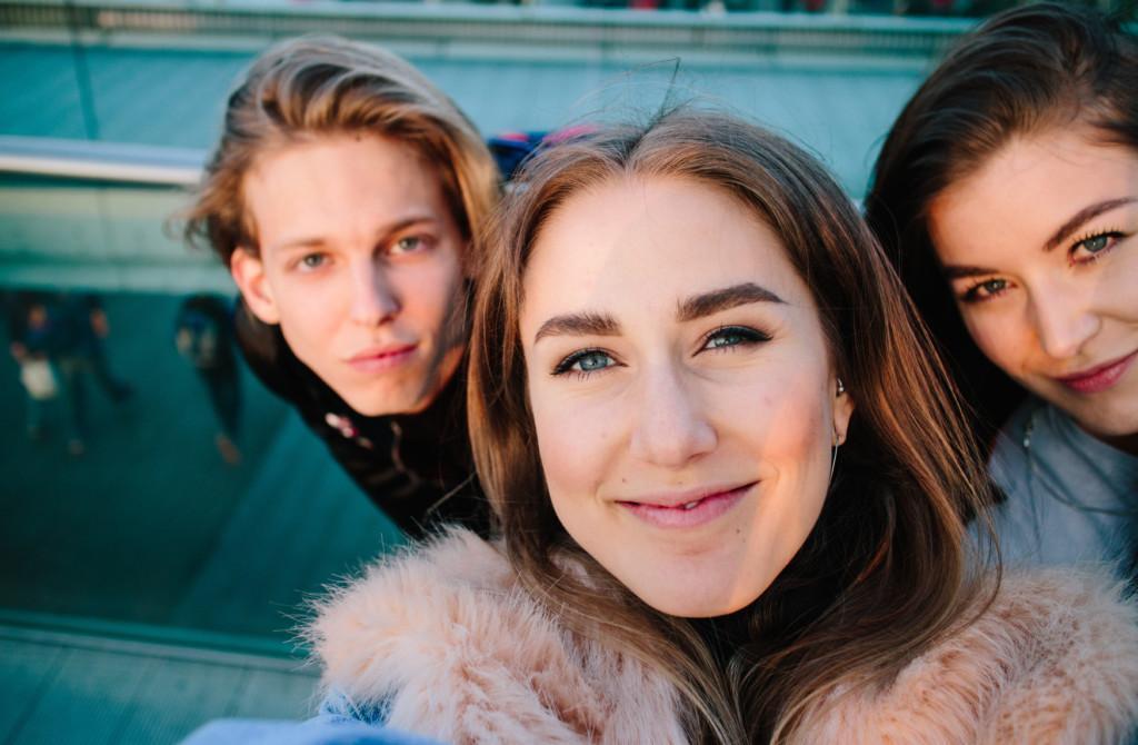 Happy youth taking a selfie